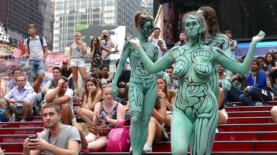 Naked people wearing nothing but bodypaint in public