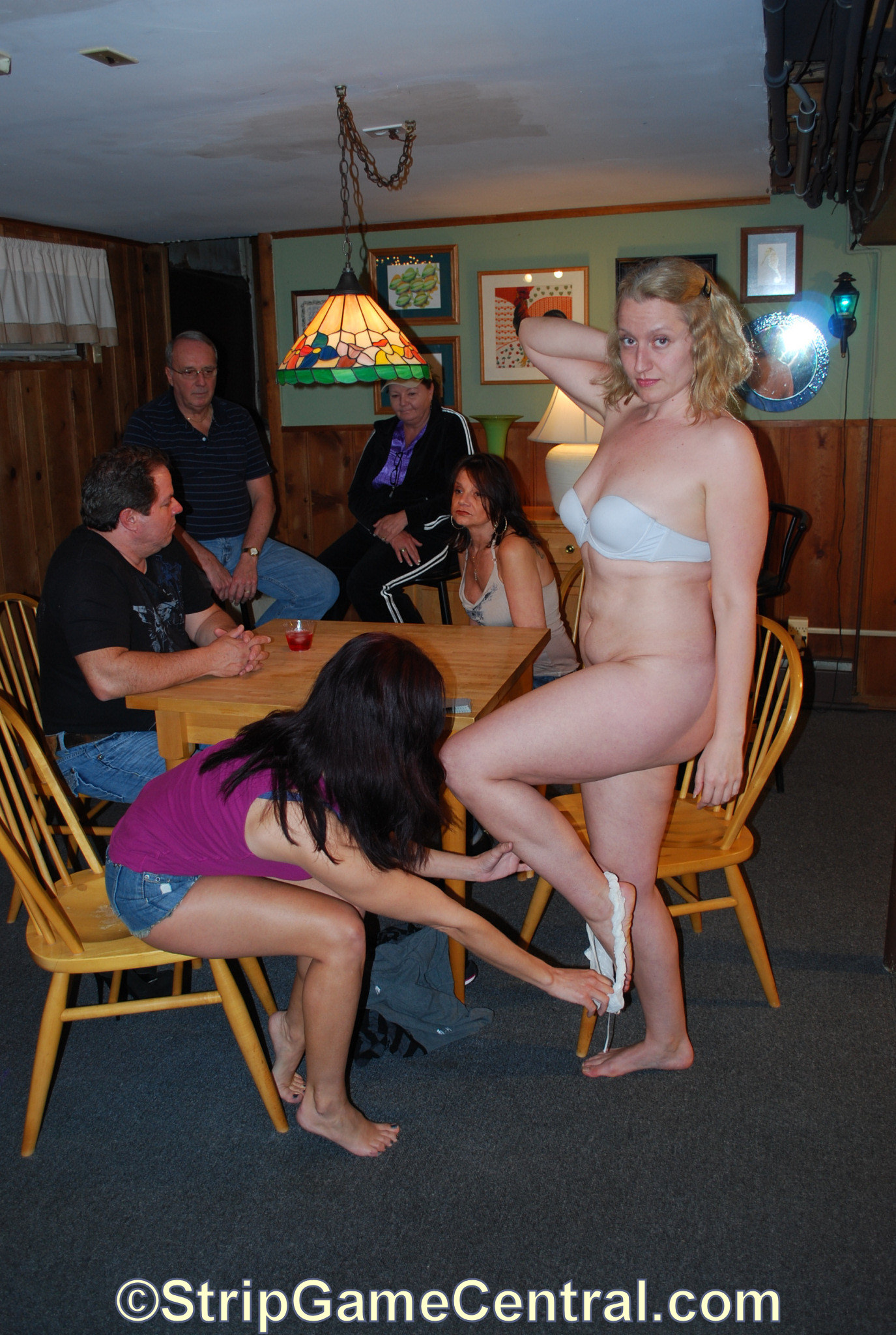 Strip game in front of an audience