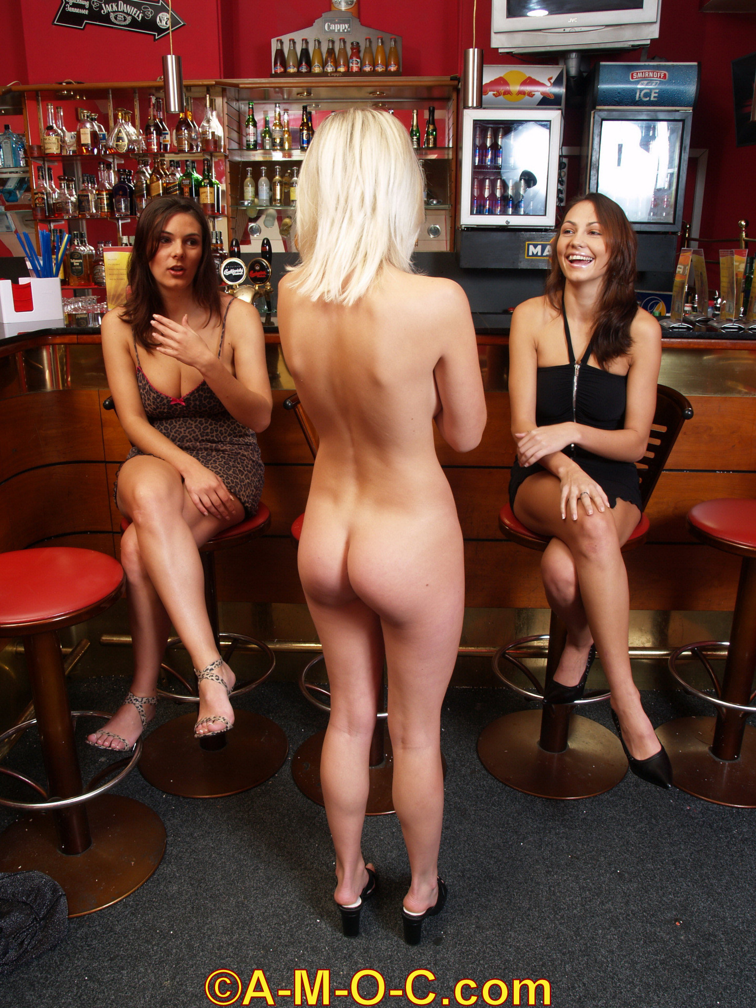 Davina stands naked in front of her friends